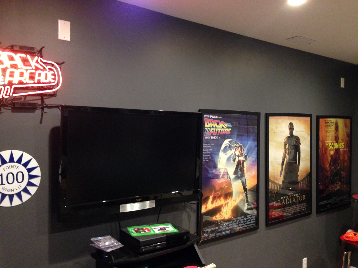 Movie posters plus game room TV