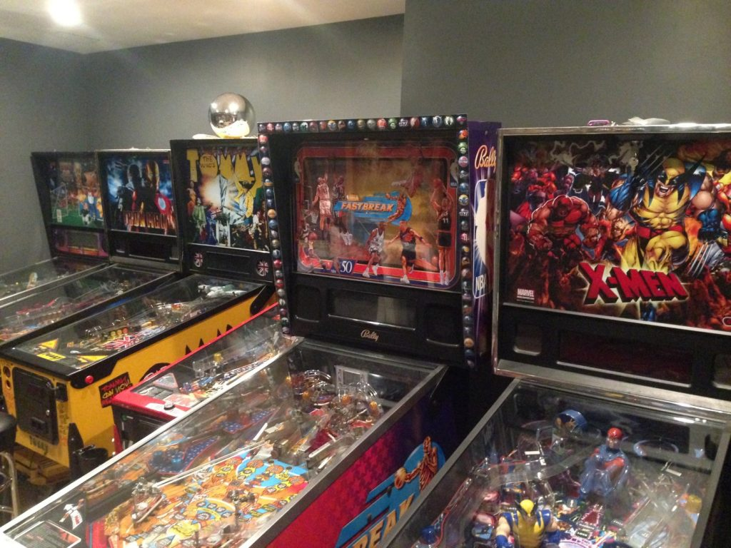 Row of pinball machines in a Game Room