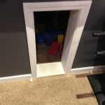 Kid's playroom under the stairs in the game room