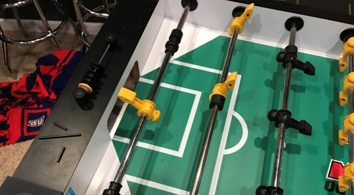 Tornado Foosball converted from three goalies to one