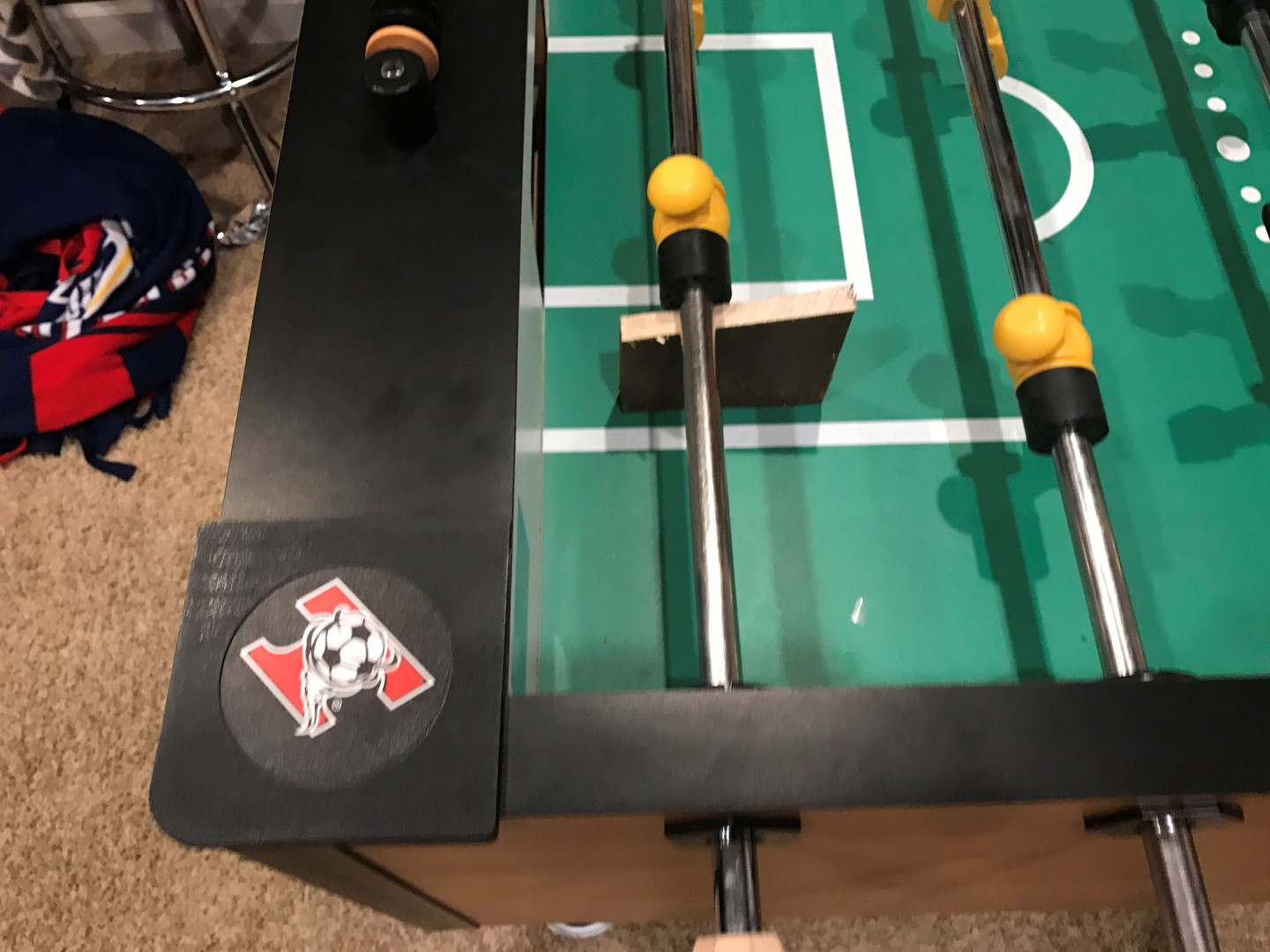 wood block used to add and remove foosball players