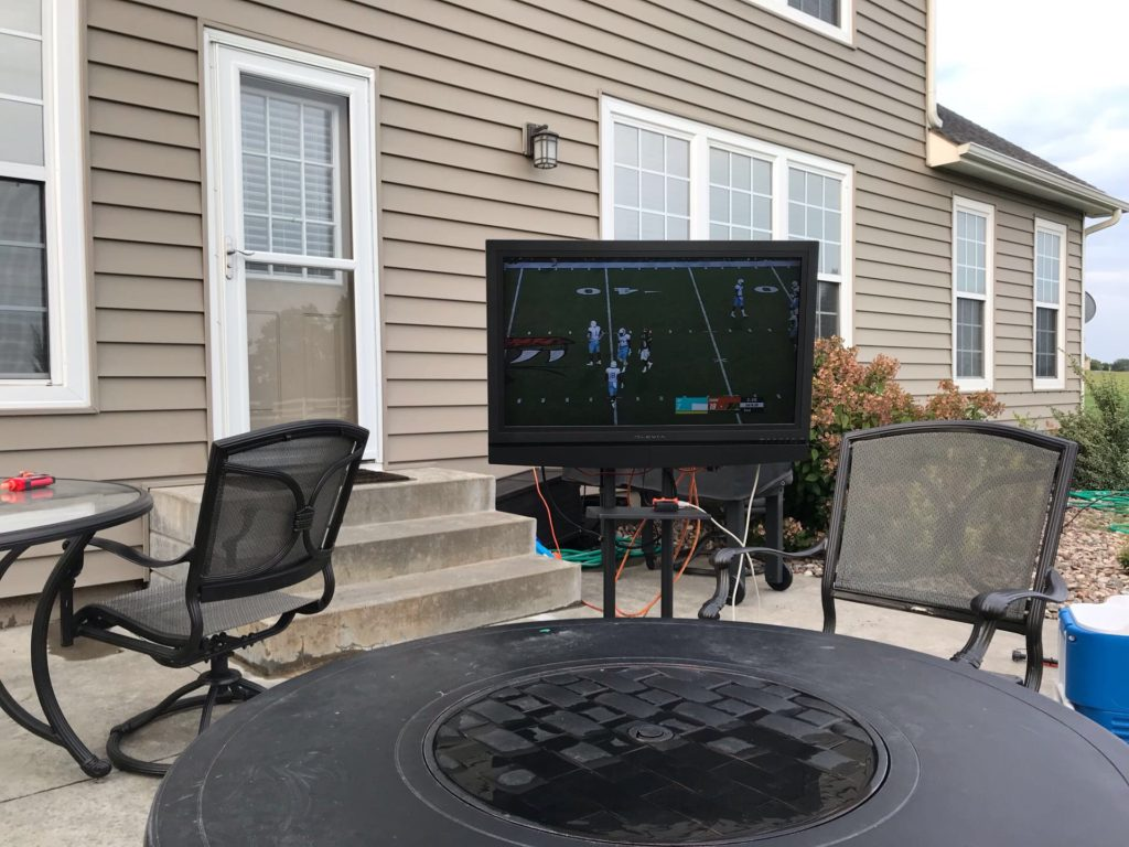 Outdoor TV rolling stand during the day